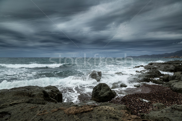 Stock photo: Rough seas and dark clouds over Sardinian coastline
