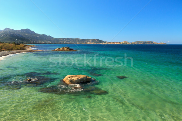 Looking towards the citadel of Calvi from rocks near Plage de Pe Stock photo © Joningall