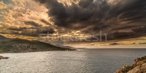 Moody sky over the coast of Corsica near Ile Rousse Stock photo © Joningall