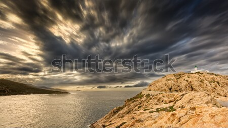 Moody skies over the lighthouse at Ile Rousse in Corsica Stock photo © Joningall