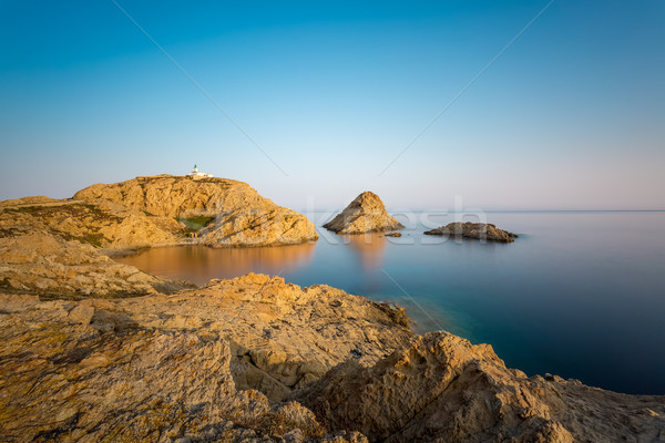 Red rocks and lighthouse of Ile Rousse in Corsica Stock photo © Joningall