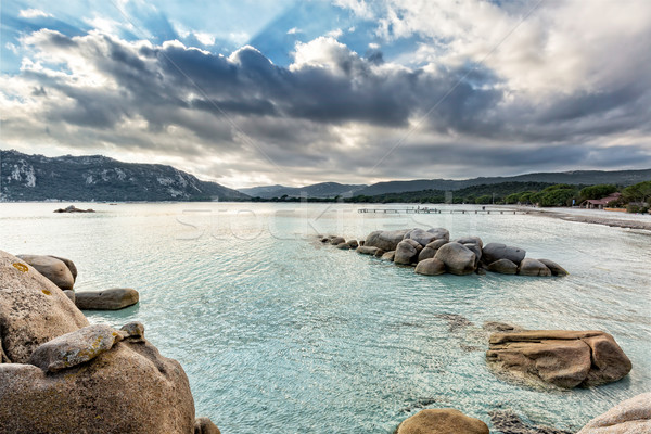 Boulders in a turquoise sea at Santa Giulia beach in Corsica Stock photo © Joningall