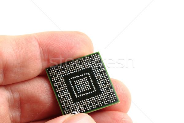 Mikrocsip emberi kéz izolált fehér technológia tábla Stock fotó © jonnysek