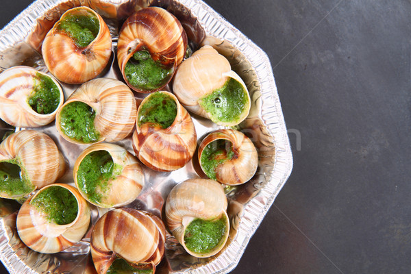 snails as nice french gourmet food background Stock photo © jonnysek