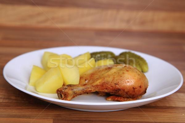 ızgara tavuk bacaklar patates yağ et cilt Stok fotoğraf © jonnysek