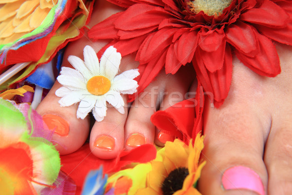 women feets and flowers (pedicure tbackground) Stock photo © jonnysek