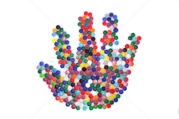 color plastic caps as hand Stock photo © jonnysek