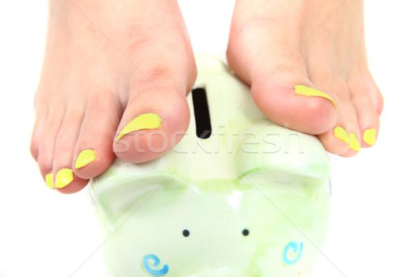 Vrouwen voeten pedicure munt bank geïsoleerd Stockfoto © jonnysek