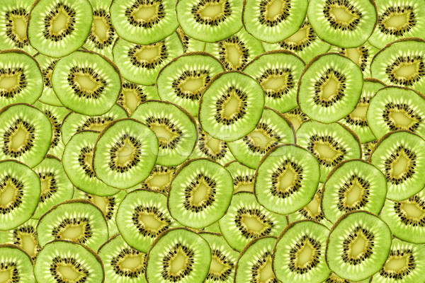 natural green background from the slices of kiwi Stock photo © jonnysek