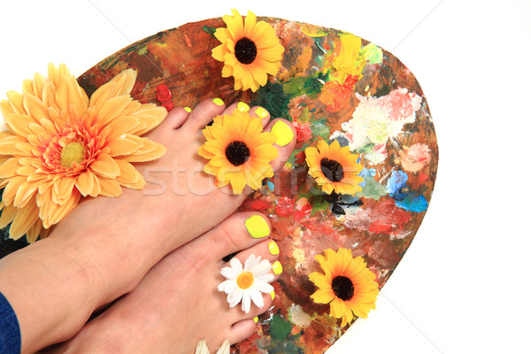 Kadın ayaklar pedikür çiçekler yalıtılmış beyaz Stok fotoğraf © jonnysek