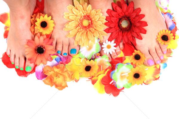 women feet (pedicure)  with flowers Stock photo © jonnysek