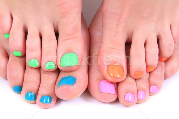 Pedicure colore chiodi donne piedi isolato Foto d'archivio © jonnysek