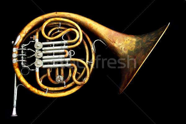 Old french horn isolated on the black background Stock photo © jonnysek
