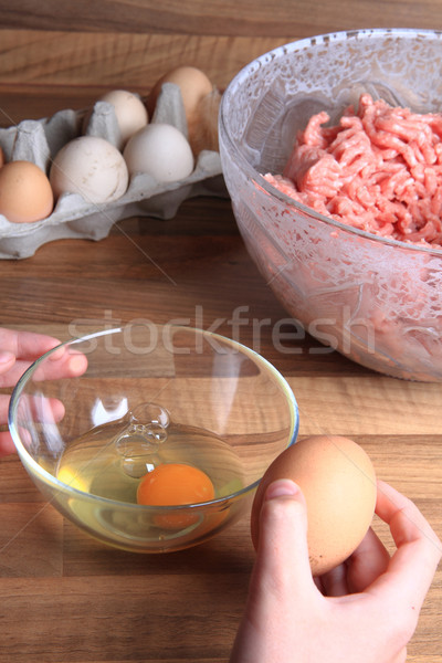 crashing eggs for preparing food Stock photo © jonnysek