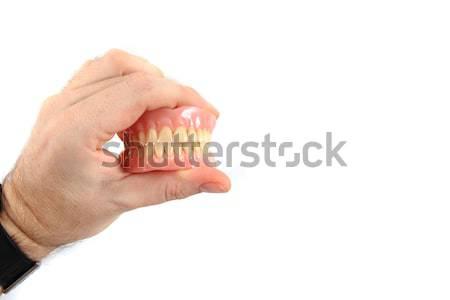 teeth prosthesis in human hand Stock photo © jonnysek