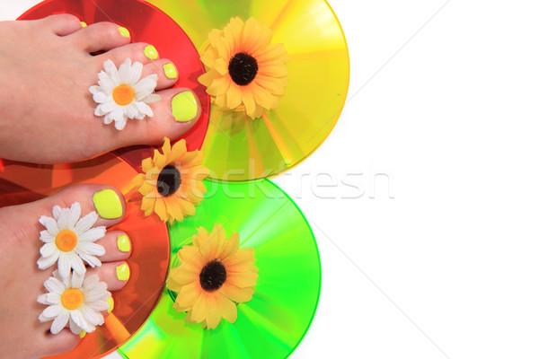 Vrouw benen pedicure gekleurd nagels geïsoleerd Stockfoto © jonnysek