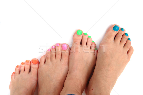 Pedicure kleur nagels vrouwen voeten geïsoleerd Stockfoto © jonnysek
