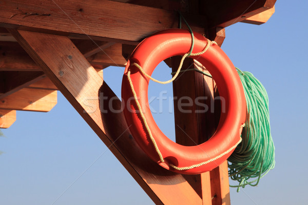 Reddingsboei strand blauwe hemel oranje helpen leven Stockfoto © jonnysek