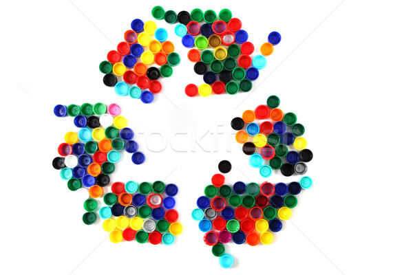 symbol recycle from color plastic caps Stock photo © jonnysek