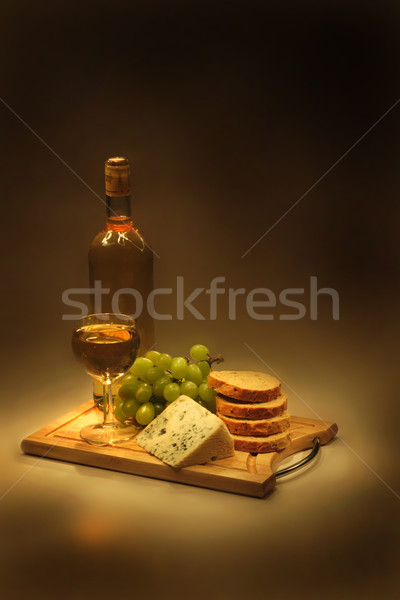 wine, grapes, cheese and bread in the night Stock photo © jonnysek