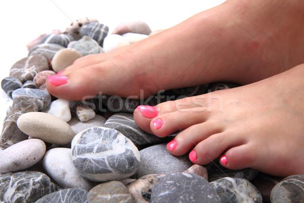 Nő láb pedikűr kövek izolált fehér Stock fotó © jonnysek