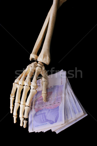 Dead bone hand cover money notes Stock photo © joruba