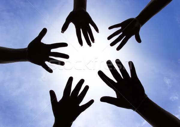 Comunidade cinco mãos símbolo união tocar Foto stock © joruba
