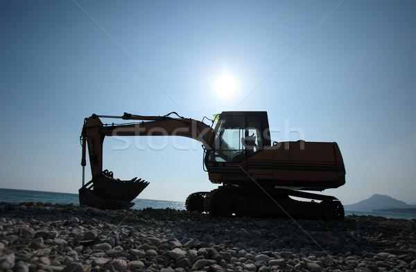 Escavadora silhueta em pé sol imagem céu Foto stock © joruba