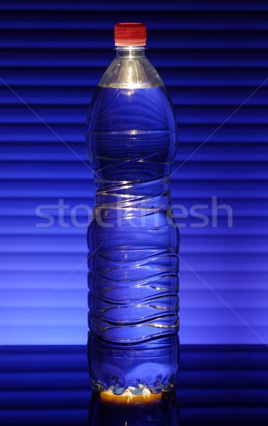 Garrafa azul cor água estúdio líquido Foto stock © joruba