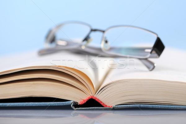 Livro óculos livro aberto azul educação óculos Foto stock © joruba