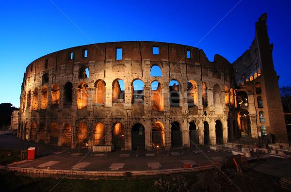 Coliseu Roma noite Itália céu azul Foto stock © joruba