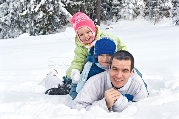 Family in snow Stock photo © joseph73