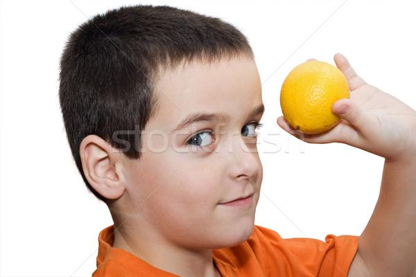 Boy with lemon Stock photo © joseph73