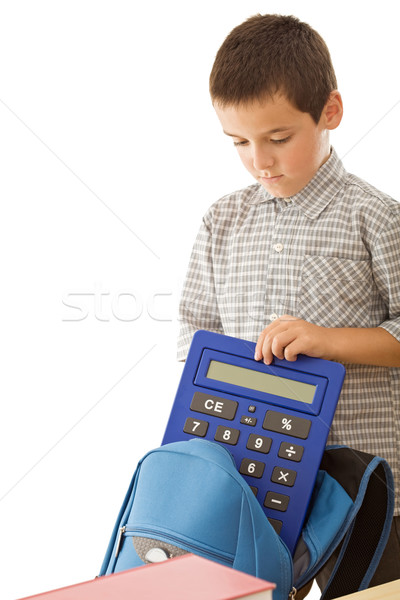 Schoolboy putting a calculator in the schoolbag Stock photo © joseph73