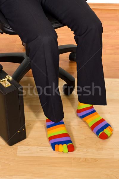 Szokatlan üzletember ül fotel visel színes Stock fotó © joseph73