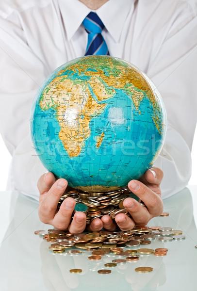Businessman holding globe Stock photo © joseph73