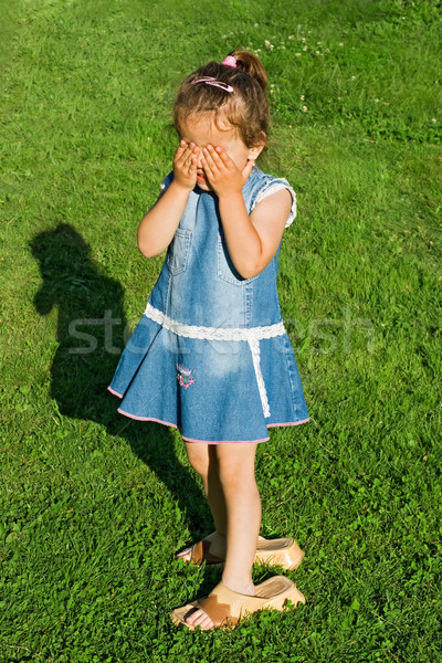 Little girl playing hide-and-seek Stock photo © joseph73