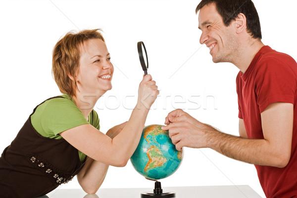 пару глядя другой счастливым увеличительное стекло женщину Сток-фото © joseph73