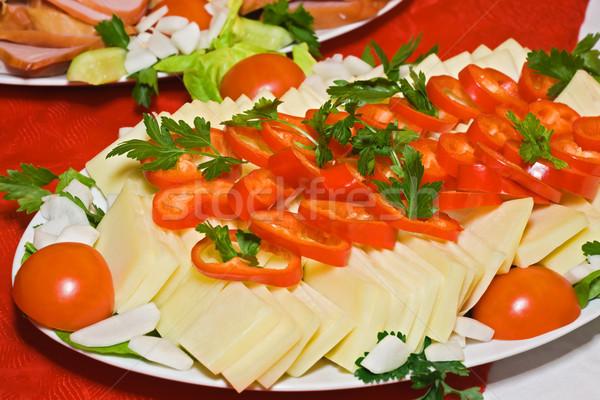 сыра овощей Ломтики свежие овощи фон зеленый Сток-фото © joseph73