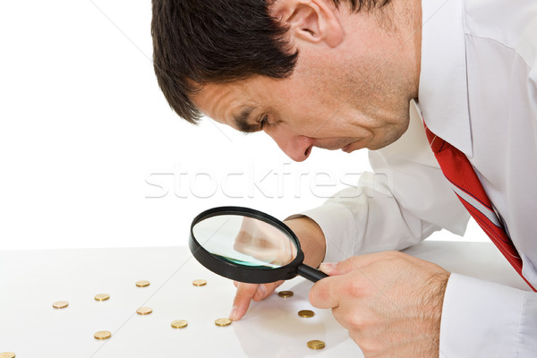 Businessman with magnifying glass Stock photo © joseph73