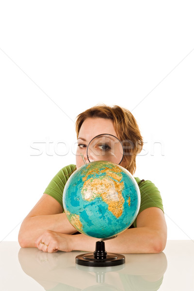 Stock photo: Woman looking at globe