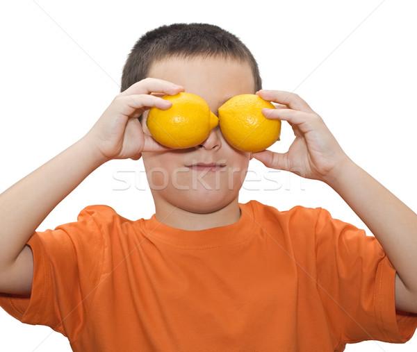 мальчика лимоны играет два продовольствие лице Сток-фото © joseph73