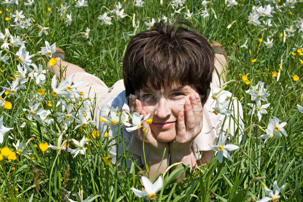 Woman leaning on her elbows in green grass Stock photo © joseph73