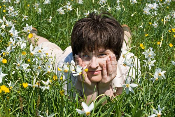Nő dől zöld fű virágok lány tavasz Stock fotó © joseph73