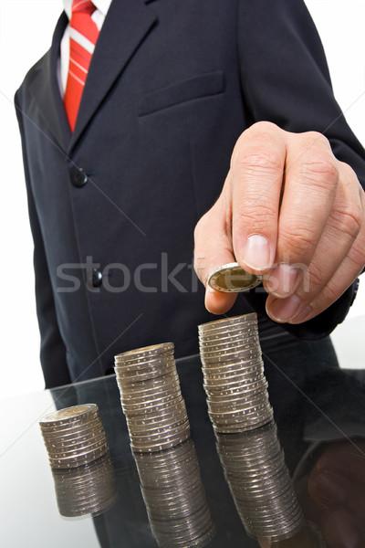 бизнесмен монетами колонн бизнеса стороны мужчин Сток-фото © joseph73