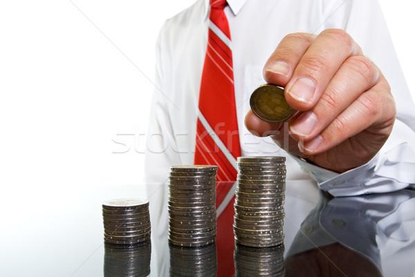 Biznesmen monet kolumny działalności ceny strony Zdjęcia stock © joseph73