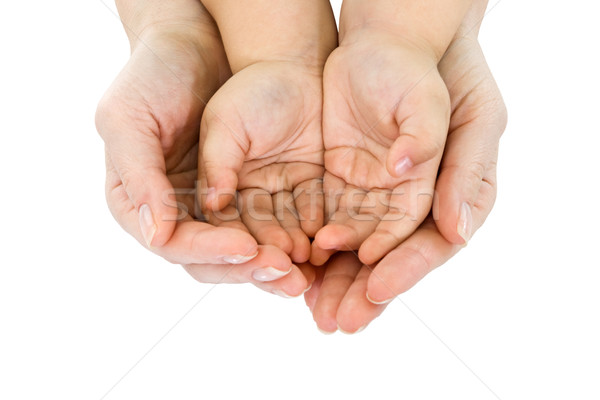 Woman hand hold a child's handful Stock photo © joseph73