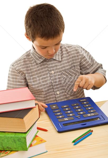 Schoolboy with calculator Stock photo © joseph73