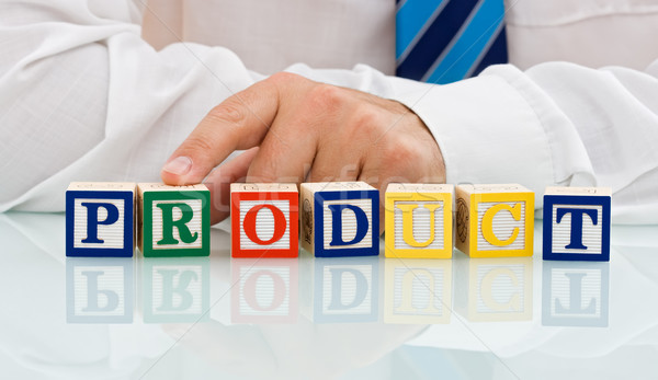 Zakenman blokken aanraken woord product business Stockfoto © joseph73
