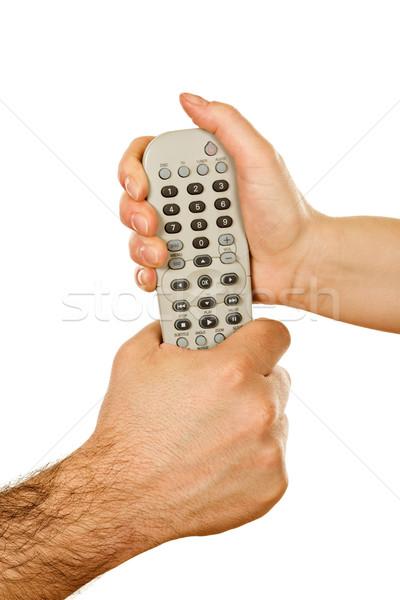 Hands holding a remote control Stock photo © joseph73